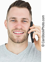 Close-up portrait of young man using mobile phone