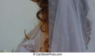 Close-up portrait of young white bride.