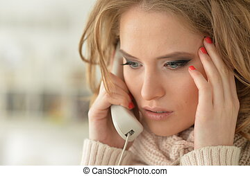 Close up portrait of young woman with the phone