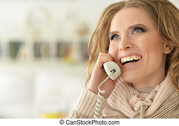 Close-up portrait of young woman with the phone