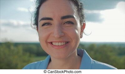 Close up Portrait Young Woman Looking in the Camera at Sunset.