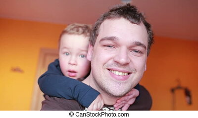 Close up portraits of happy father and his son.