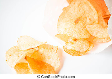 Close up potato chips falling out of the bag