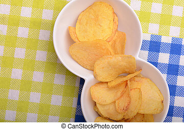 Close up potato chips. top view background