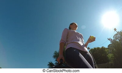 Close up pov with woman preparing for tennis match