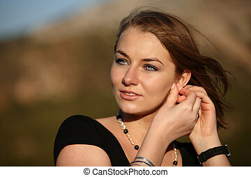 close-up pportrait of a pretty young blondse woman outdoors