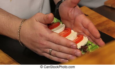 close up preparing salad with mozzarella