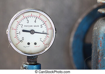 Close up pressure gauge with compressor. - Close up pressure...
