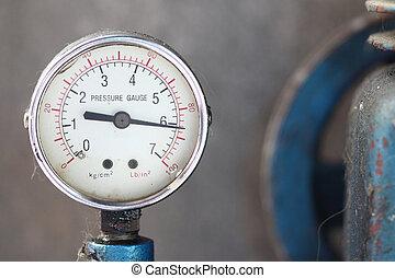 Close up pressure gauge with compressor. - Close up pressure...