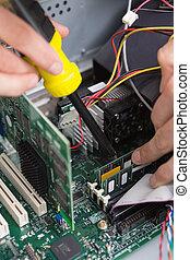 Close-up process of repairing computer