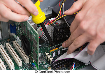 Close-up process of repairing computer