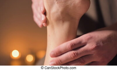 Close-up Professional physiotherapist male masseur in an ...