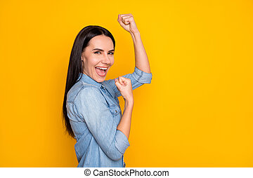 Close-up profile side view portrait of her she nice attractive lovely pretty charming content cheerful cheery girl celebrating lucky day isolated on bright vivid shine vibrant yellow color background