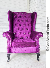 purple chair in white room