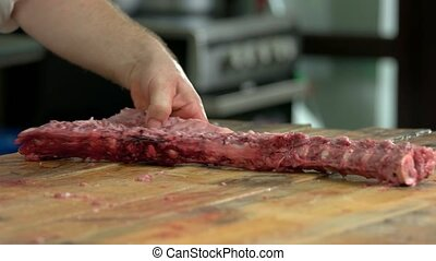 Close up raw meat on table at butchery. Fresh bloody meat at...