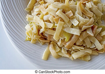 close up ready to eat pasta on a plate