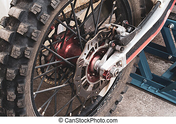 Close-up rear studded wheel off-road motorcycle