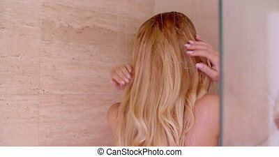 Close up Rear View of a Blond Woman Under a Shower