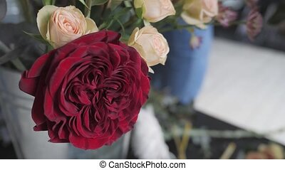 Close up red blooming roses. Flowers at flower shop,...