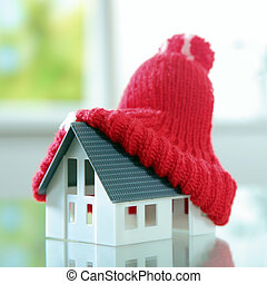Close up Red bobble hat on Cute Little House