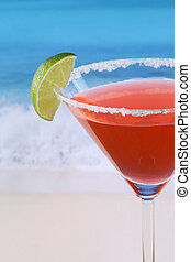 Close up red Martini cocktail on the beach