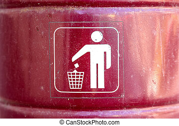 Close up red metal garbage bin with white sign on