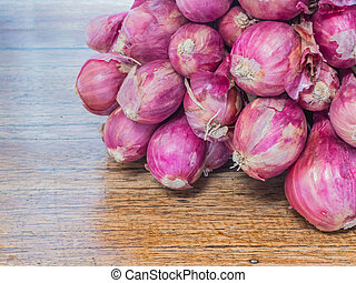 red onion on wood table