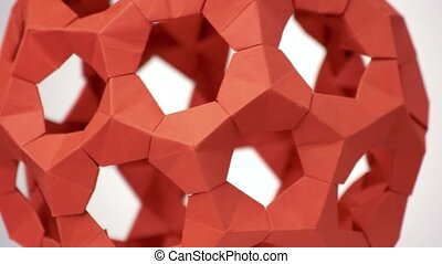 Close up red rotating modular origami.