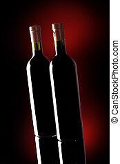 Close-up red wine bottle on dark background