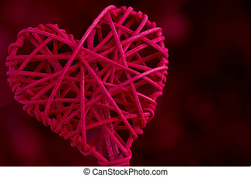 Close Up Red Woven Heart with a Dark Red Background