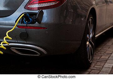 Close-up refueling an electric car.