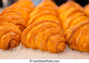 Close up resh homemade croissants on table and selective focus.