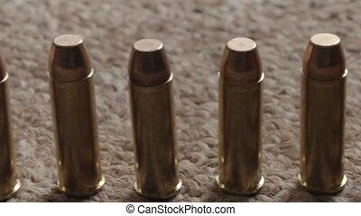 close-up rifle ammunition on the carpet - rifle cartridges...