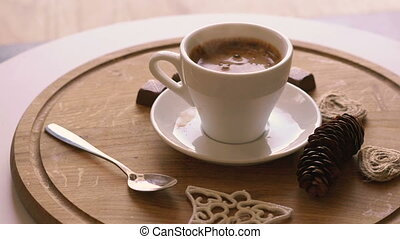 Close up rotating wooden background with coffee, candies and biscuit