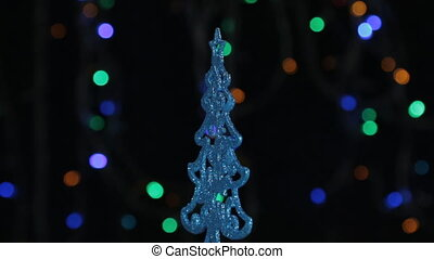 Close-up, rotation of a blue Christmas tree. Christmas and...