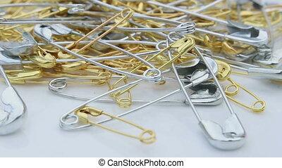 safety pin rotating - close up safety pin rotating