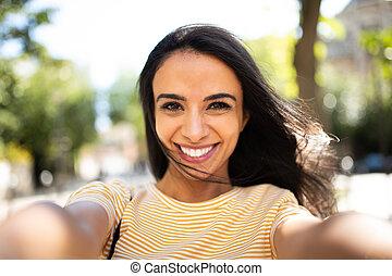 selfie portrait smiling young hispanic woman outside