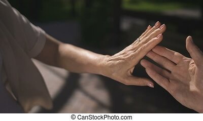 Close-up senior hands while man proposing to woman -...