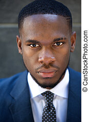 Close up serious businessman in suit and tie