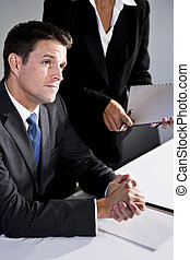 Close-up serious businessman sitting in boardroom