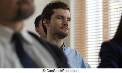 Close up serious man skeptically listening speaker - Close...