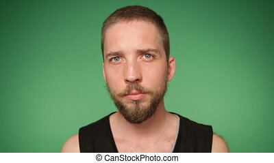 serious man's face with trendy beard and mustache - Close up...