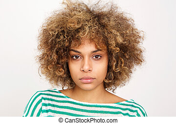 Close up serious young african american woman against white background