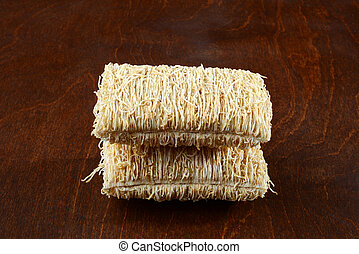 close up serving shredded wheat cereal on wood table