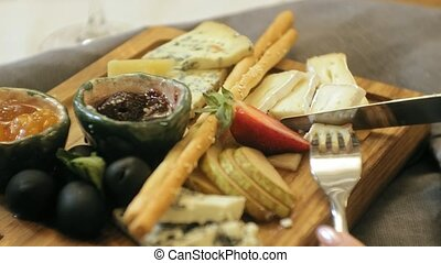close-up shooting: delicious cheese platter with sauces,...