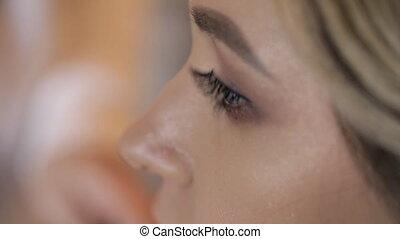 Close up shooting face bride Make-up artist doing makeup lip...