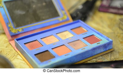 Close-up shooting of palette with taking rouge with brush...