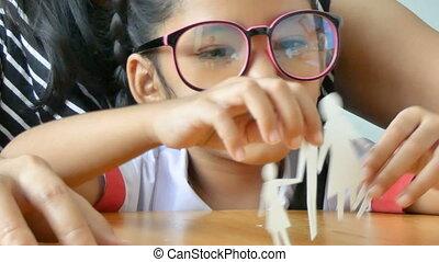 Close up shot Asian little girl in Thai kindergarten student...