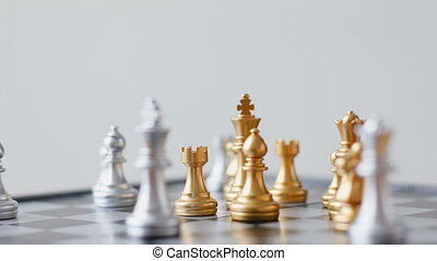 Close up shot hand of business woman moving gold chess on chess board game for business challenge metaphor and business competition concept shallow depth of field