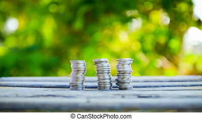 Close up shot hand of woman stacking the coins